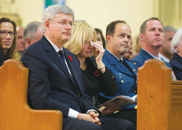 Prime Minister Stephen Harper, his wife Laureen and General Thomas Lawson, Chief of the Defence Staff, mourn the loss of Corporal Nathan Cirillo during the regimental funeral at Christ's Church Cathedral.(PMO photo by Jason Ransom)