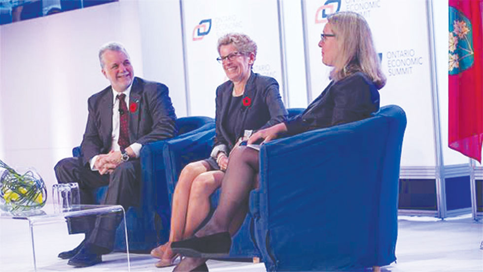 Quebec Premier Philippe Couillard (left) along with the Premier of Ontario, Kathleen Wynne, at the Ontario Economic Summit which took place in Niagara-on-the-Lake on Friday, October 24.