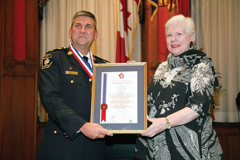 York Regional Police Chief Eric Jolliffe (left) receiving his award from the Lieutenant Governor of Ontario, Elizabeth Dowdeswell.                                                                                                          Photo by Salam Toronto