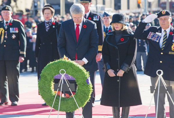 Prime Minister Stephen Harper and his wife Laureen lay a wreath during the Remembrance Day Ceremony at the National War Memorial.                                                    (PMO photo by Jason Ransom)