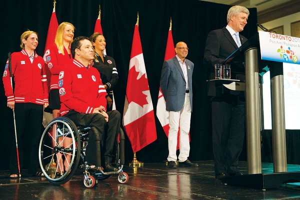 Prime Minister Stephen Harper, joined by Saäd Rafi, Chief Executive Officer of the TORONTO 2015 Pan Am/Parapan Am Games Organizing Committee, and Canadian athletes Élise Marcotte, Tera Van Beilen, Priscilla Gagné, and Marco Dispaltro, delivers remarks at a reception to highlight the 2015 Pan Am and Parapan Am Games.  PMO photo by Deb Ransom
