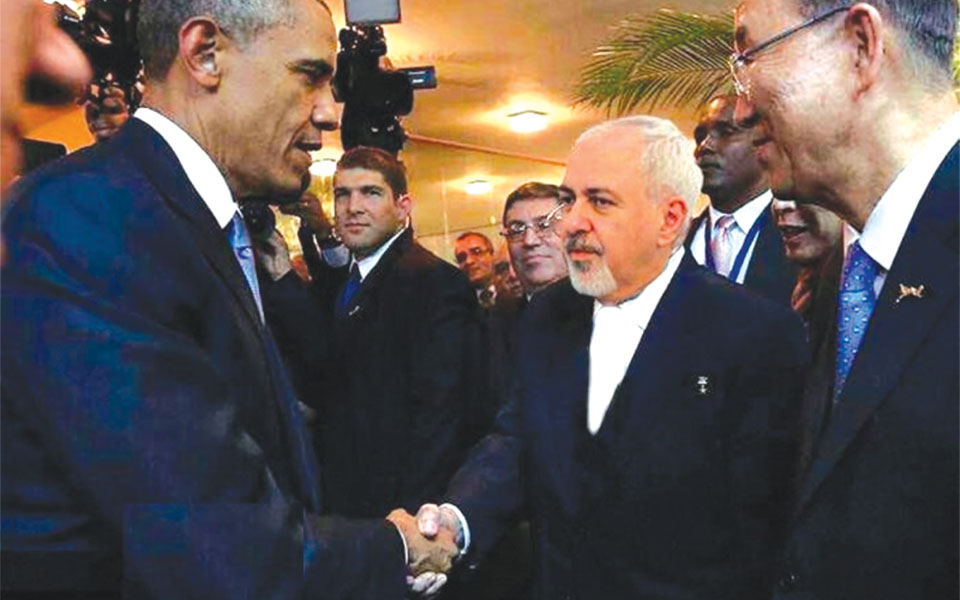 President Obama (left) shaking hands with Iran's foreign minister Mohammad Javad Zarif on the sidelines of the UN General Assembly on Monday, September 28, 2015.