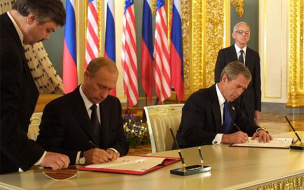 Presidents Vladimir Putin and George W. Bush signing the Strategic Offensive Reductions Treaty on May 24, 2002, in Moscow.
