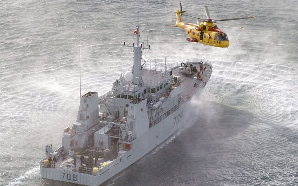 HMC Saskatoon off Vancouver Island, practicing personnel transfers, with CH-149 Cormorant helicopter.